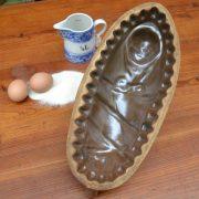 Starožitná pečící forma miminko s mašlí
