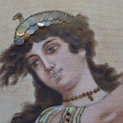 Pestře vyšívaný starožitný obraz