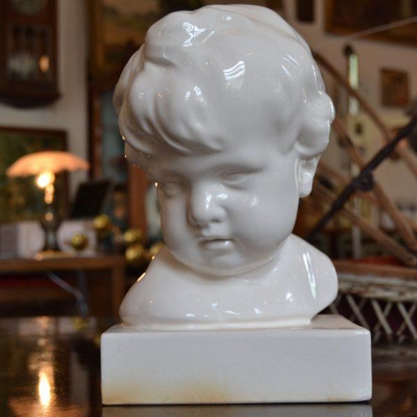 Starožitná busta dítěte