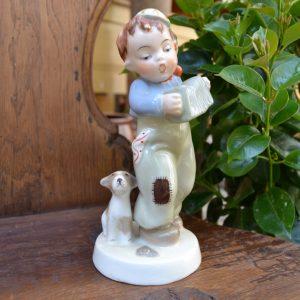 Starožitná soška harmonikář a psík