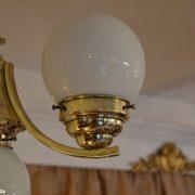 Mosazný starožitný lustr